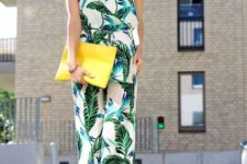 With white top, yellow necklace, platform sandals and yellow clutch