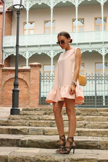 With yellow chain strap bag and lace up high heels