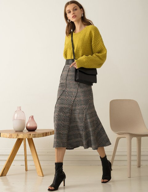 With yellow sweater, black crossbody bag and black cutout boots