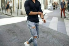 a black shirt, blue ripped skinnies, white sneakers are a timelessly cool combo