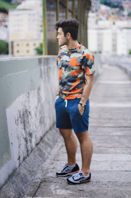 a bright outfit with a colorful t-shirt, bright blue shoes and black and white trainers