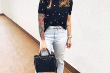 a chic look with bleached ripped jeans, a black pearl tee, black loafers and a black bag