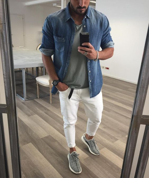 a green tee, a blue denim shirt, white jeans and grey sneakers for a chic summer to fall look