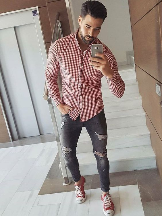 a red plaid shirt, blue ripped jeans and red sneakers for a touch of color in your outfit