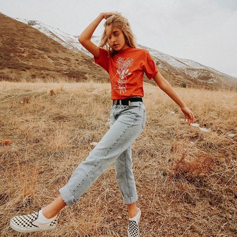 a red printed tee, bleached jeans, checked slipons for a stylish summer look with a 90s touch