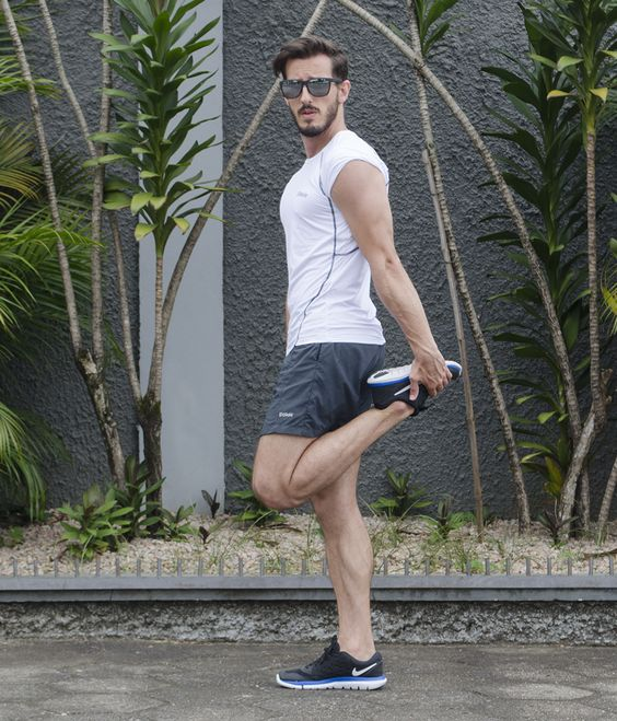 a white fitting t-shirt, black shorts, black trainers for a stylish and cool workout look