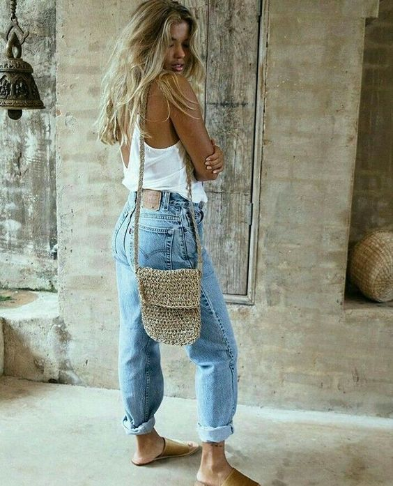 bleached baggy jeans, a white top, a wucker bag and brown slippers for a comfortable summer look