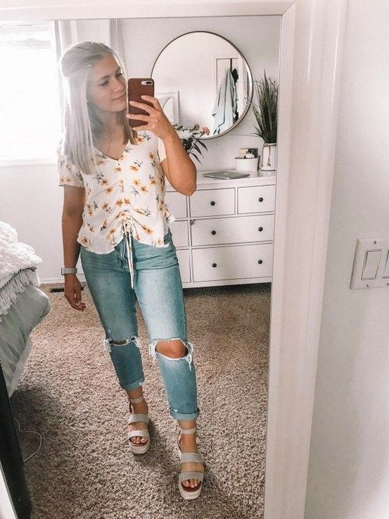 bleached ripped jeans with a floral shirt and comfortable wide strap sandals