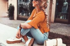 bleached skinnies, a rust-colored polka dot shirt, white sneakers and a white bag for a summer to fall look
