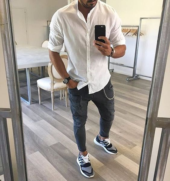 grey jeans, a white shirt and grey trainers for a simple transitional everyday look