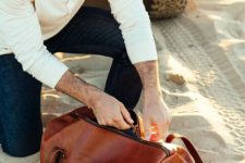 02 a chic cognac-colored leather bag that isn't very large won't take much space around