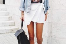 03 a black printed tee, a white asymmetrical mini skirt, a bleached denim jacket, taupe boots and a backpack