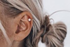 03 a shiny and bright star-shaped helix piercing is a cute and trendy idea for a modern girl