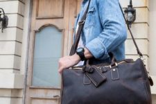 03 a small dark brown leather travel bag with a tag and gold hardware for a stylish manly look