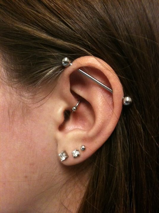 several ear piercings and an industrial that crowns them all for a bold look