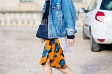 04 a black top, a bright floral knee skirt, an oversized denim jacket and black heels for a bold look