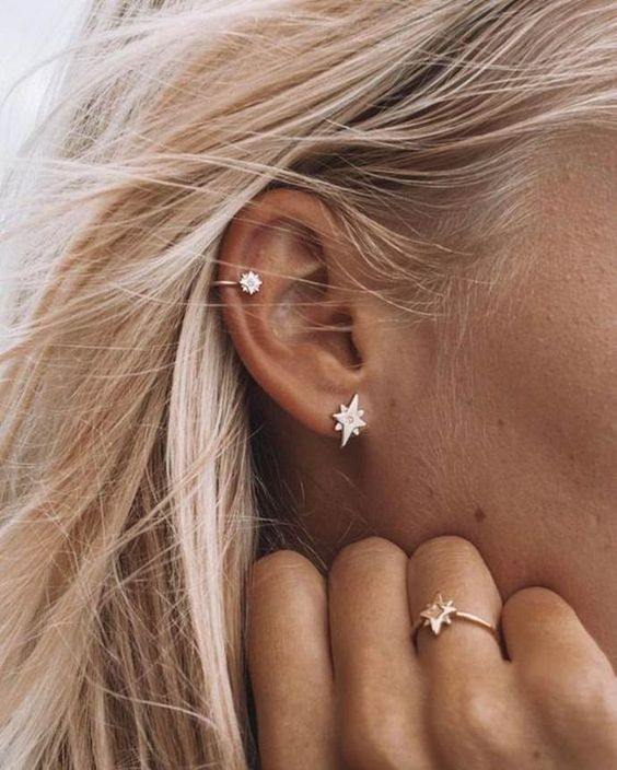 a stylish double piercing - in the lap and in the helix for a trendy touch as celestial accessories are hot