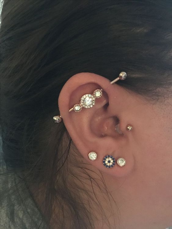 multiple bright and shiny piercings plus a matching industrial to make an impression