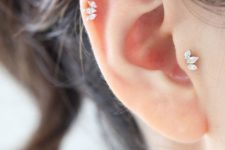 04 super chic and beautiful jeweled leaf stud piercings – tragus and helix for a refined look