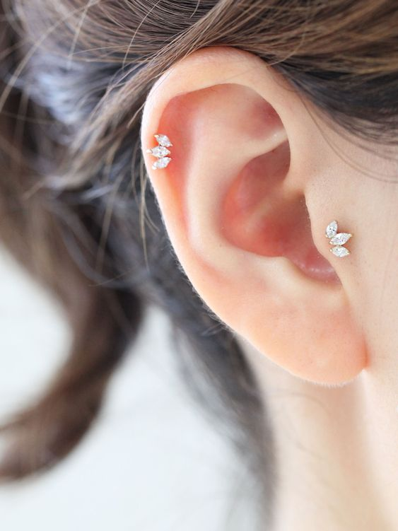 super chic and beautiful jeweled leaf stud piercings - tragus and helix for a refined look