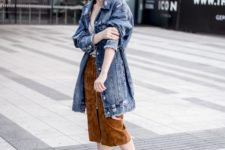 05 a neutral top, a rust-colored suede midi skirt, embellished shoes and an oversized denim jacket