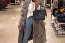05 a white long sleeve, blue jeans, black platform boots and a printed coat plus a black bag