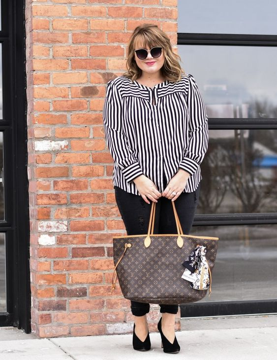 black jeans, a striped shirt, black suede booties and a comfortable tote