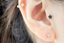 05 cute ear accessorizing with star-shaped studs in silver and black, with tragus and helix piercing