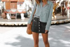 06 a grey shirt, a black denim mini skirt with a row of buttons, black boots and an amber bag