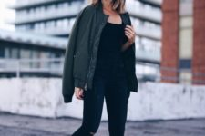 06 a simple look with black ripped jeans, a black top, white sneakers and a grene bomber jacket for chilly weather
