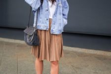 06 a white tee, a camel pleated knee skirt, white sneakers, a blue denim jacket and a graphite grey bag