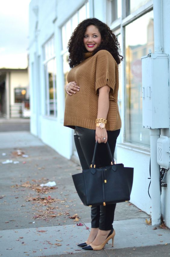 black leather leggings, two toned shoes, a camel sweater with short sleeves and a black bag