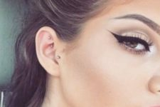 06 tragus and daith piercing with simple gold studs will spruce up your look gently