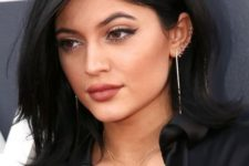 07 Kylie Jenner rocking lots of piercing hoops in her ear looks super rock and cool