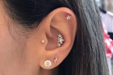 07 shiny star piecrings in the conch, daith and tragus piercing make this ear super shiny