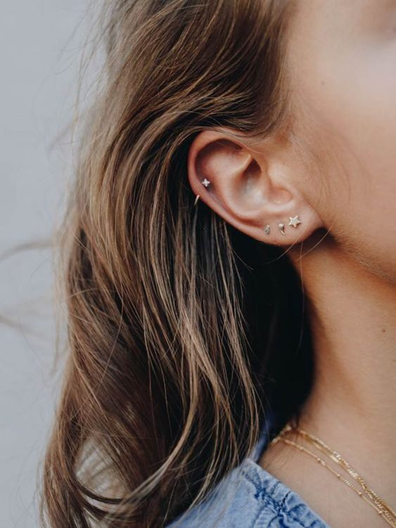 three stud earrings in the lap and a single matching one in the helix for a cute and glam look