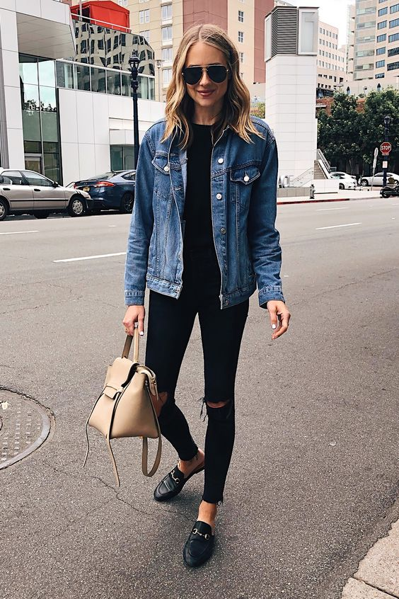 a black tee, black ripped skinnies, a blue denim jacket, black loafers and a nude bag