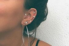 08  a boldly accessorized ear with rhinestone hoops and a giant hoop is a very chic idea
