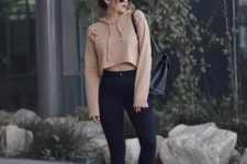 08 a cropped nude hoodie, black high waisted skinnies, black boots and sunglasses for a bit of edge