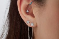 08 a double lap piercing, a helix one and an inner conch piercing with bright studs are a chic idea