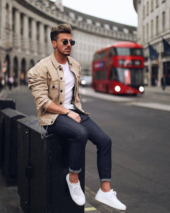 a stylish outfit with navy skinnies, a white tee, a beige jacket and white sneakers