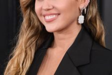 09 Miley Cyrus rocking lots of ear piercings looks super hot and rebellious