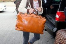 09 a comfortable amber leather travel bag will add a touch of bright color to your look