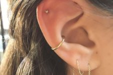 09 a gold hoop in the lower part of the conch is a chic idea to match the studs and chains