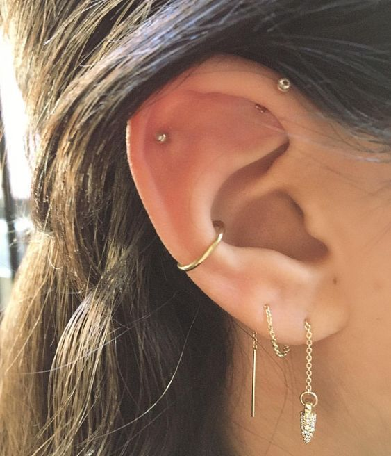 a gold hoop in the lower part of the conch is a chic idea to match the studs and chains
