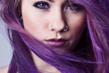 09 a symmetrical nostril piercing with two rings can be a touch of something traditional in your look
