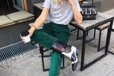 09 emerald velvet pants, a grey t-shirt, black and white cowboy boots that make a bold statement
