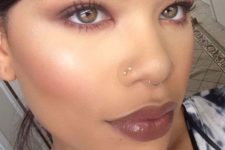 10 a chic double nose stud piercing in one nostril and an additional septum hoop