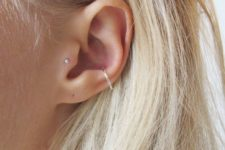 10 a minimalist look with a tragus stud and a textural hoop in the lower part of the conch