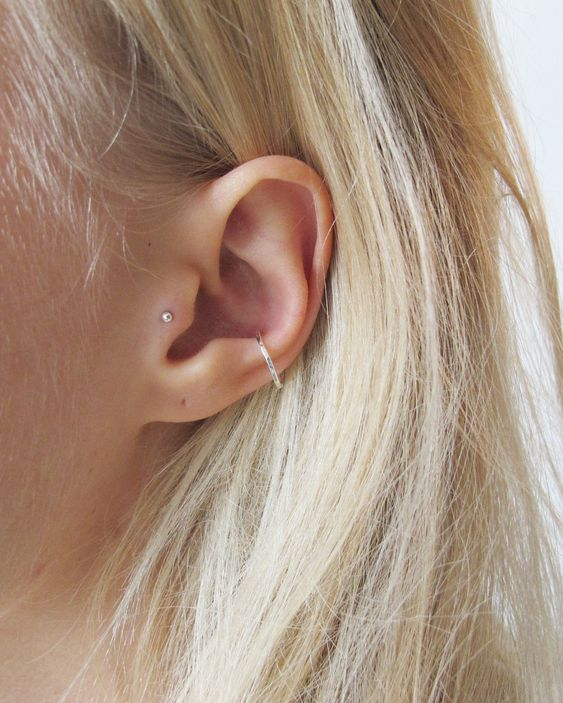 a minimalist look with a tragus stud and a textural hoop in the lower part of the conch